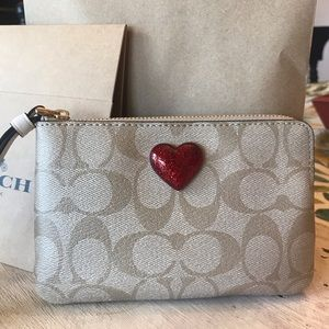 Coach signature heart wristlet in leather